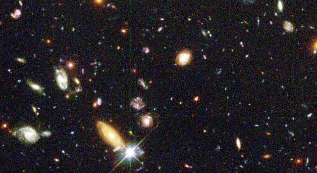 The Hubble Telescope's 1996 'Deep Field' image, showing hundreds of previously undiscovered galaxies clustered in a 'small' patch of distant space